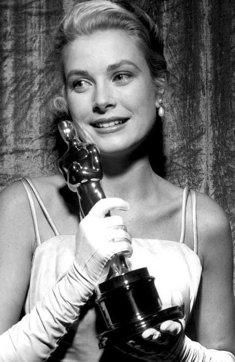 An emotional Grace Kelly holding her Best Actress Oscar.