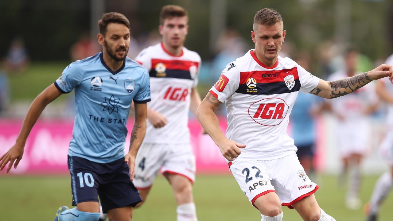 Milos Ninkovic (left) tracks Adelaide's Michael Jakobsen. Picture: Getty Images