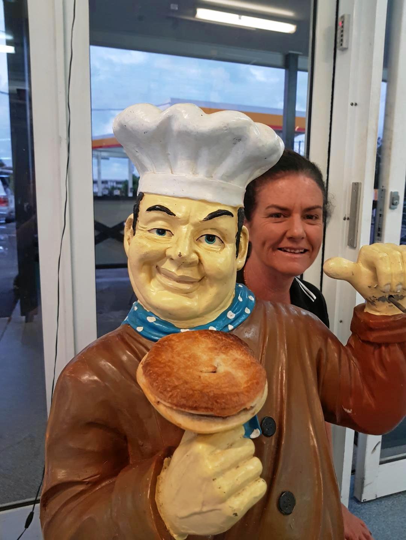 MILESTONE: Employee Michelle McGrath hides out behind mascot