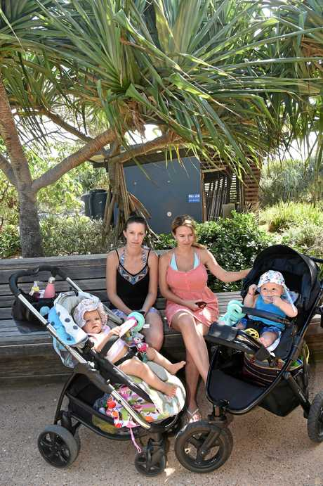 Kristy Brunswick with daughter, Charli Brunswick (9 months) and Tiffany Noble with son, Laken Noble (7 months) outside the public toilets in Coolum where there was a sexual assault.