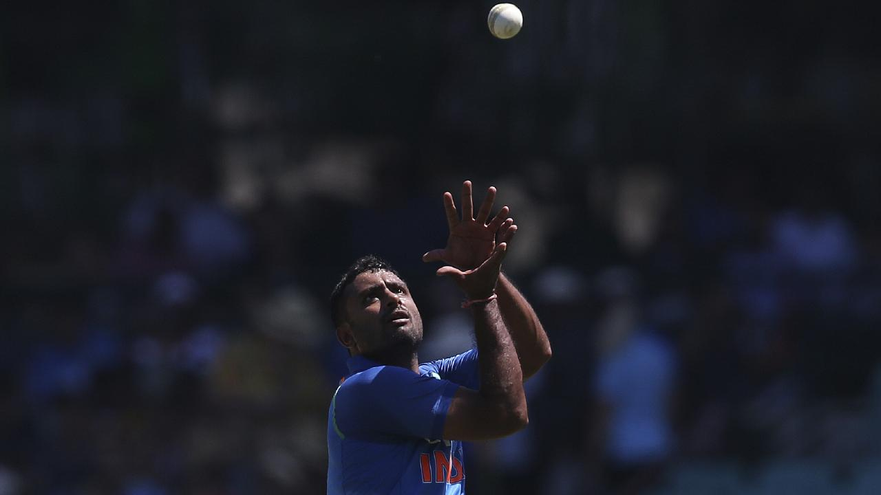 India's Ambati Rayudu retrieves the ball before bowling against Australia. Picture: AP