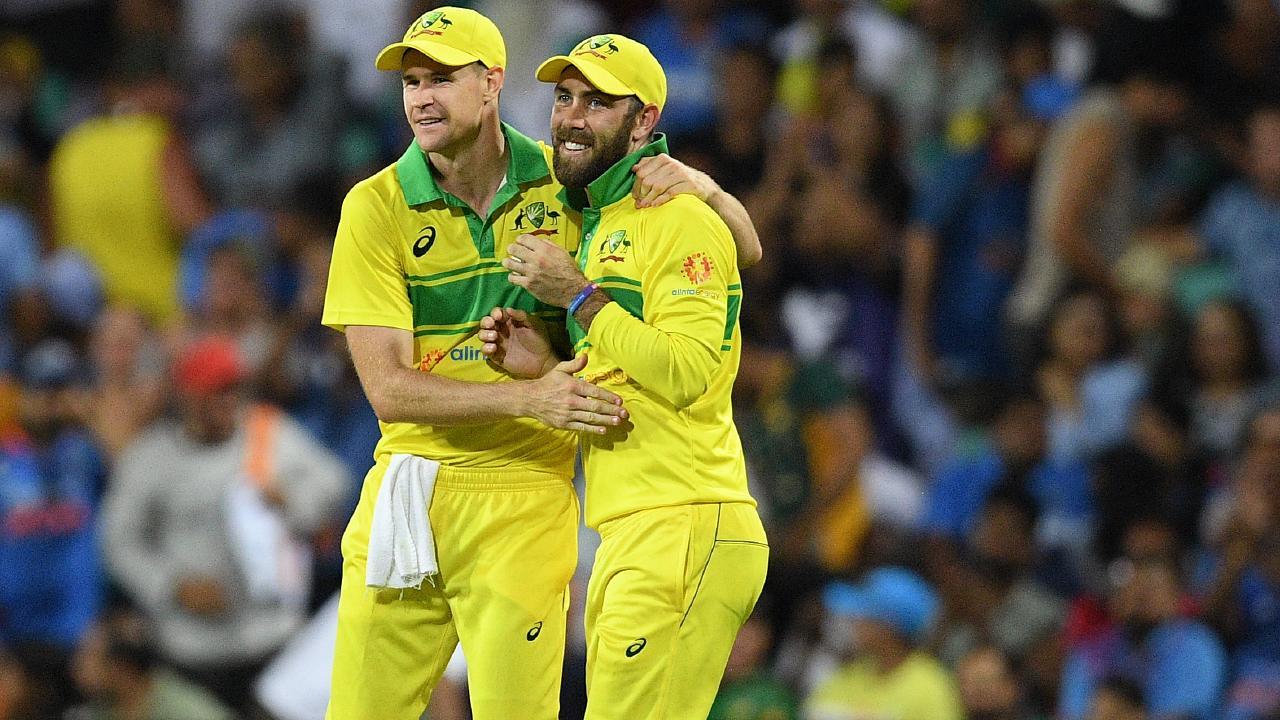 Jason Behrendorff and Glenn Maxwell celebrate a wicket.