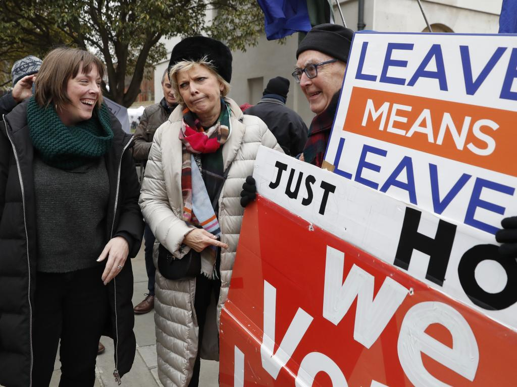 Remainer MP Anna Soubry, centre, with pro-Brexit protesters. Picture: AP/Alastair Grant
