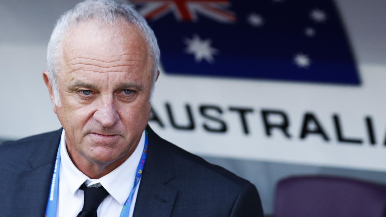 Graham Arnold remains overseas after Australia's exit from the Asian Cup. (AP Photo/Hassan Ammar)