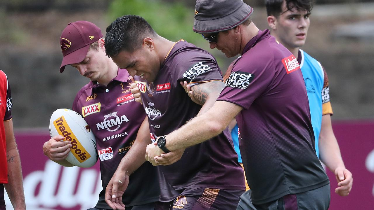 Joe Ofahengaue leaves the field injured during the Broncos intense training session at Red Hill today.