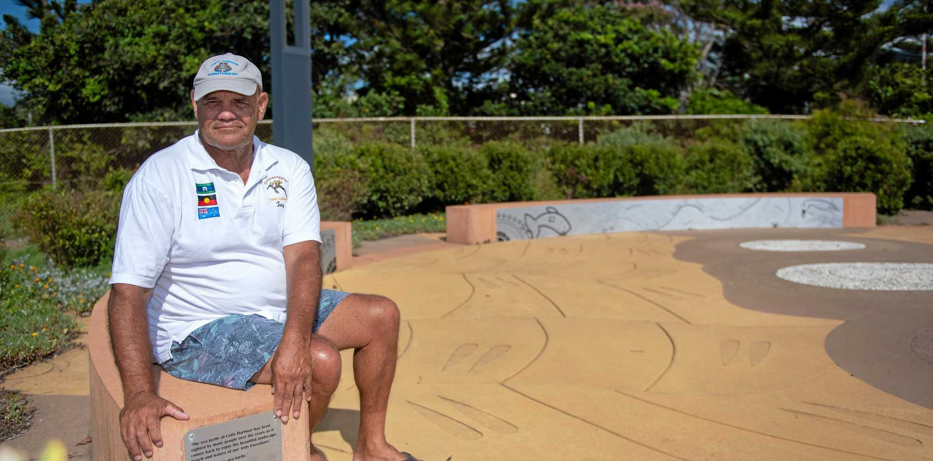 ENCHROACHED UPON: Tony Hart at the Jetty Foreshore pathway which features his artwork.