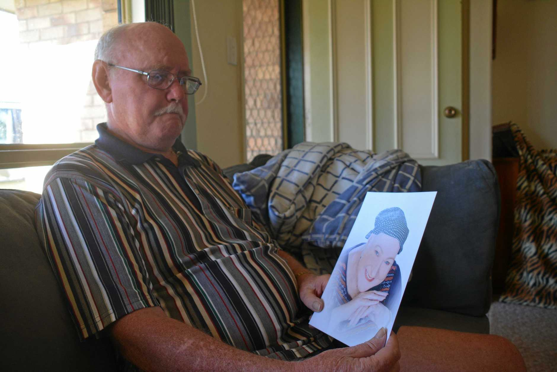 CANCER BATTLE: Kevin Allen sits in his late wife's favourite spot in their Kingaroy home as he shares about Linda's passion for helping others.