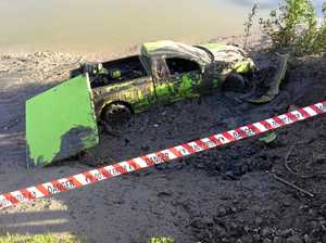 Ute crashes into river while looking for a crocodile