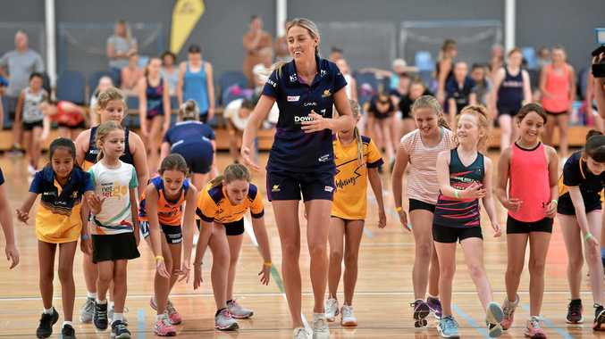 Sunshine Coast Lightning netball clinic at the Caloundra Indoor Stadium.Cara Koenen takes the gils on a warm up drill.