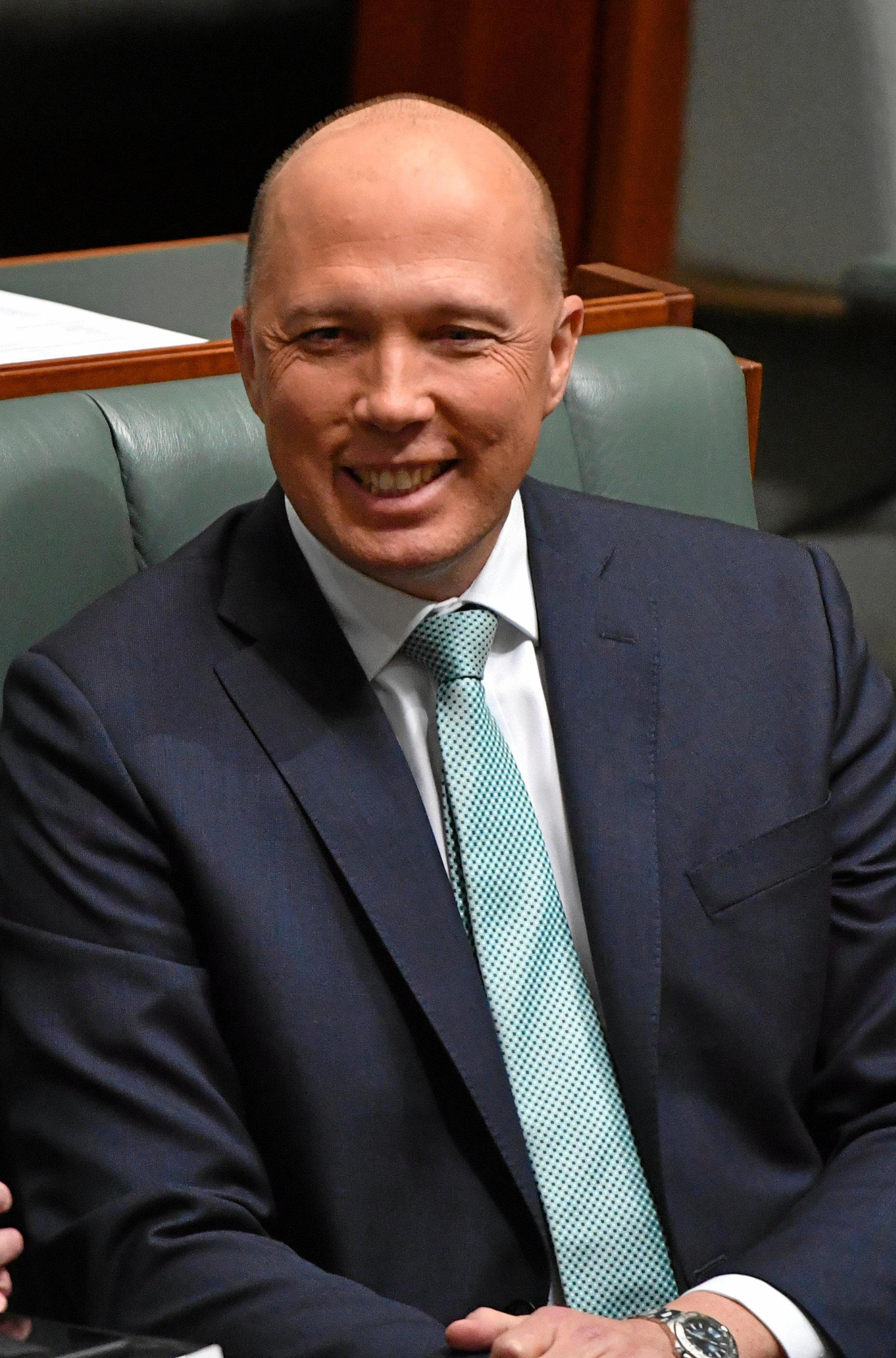 Former minister for Home Affairs Peter Dutton during a division in the House of Representatives at Parliament House in Canberra, Thursday, August 23, 2018. (AAP Image/Mick Tsikas) NO ARCHIVING
