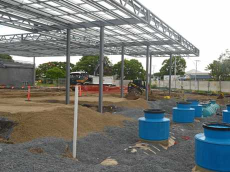 PUMPED: The United Petroleum service station under construction on the corner of  Alma and Albert streets, facing the Bruce Highway.