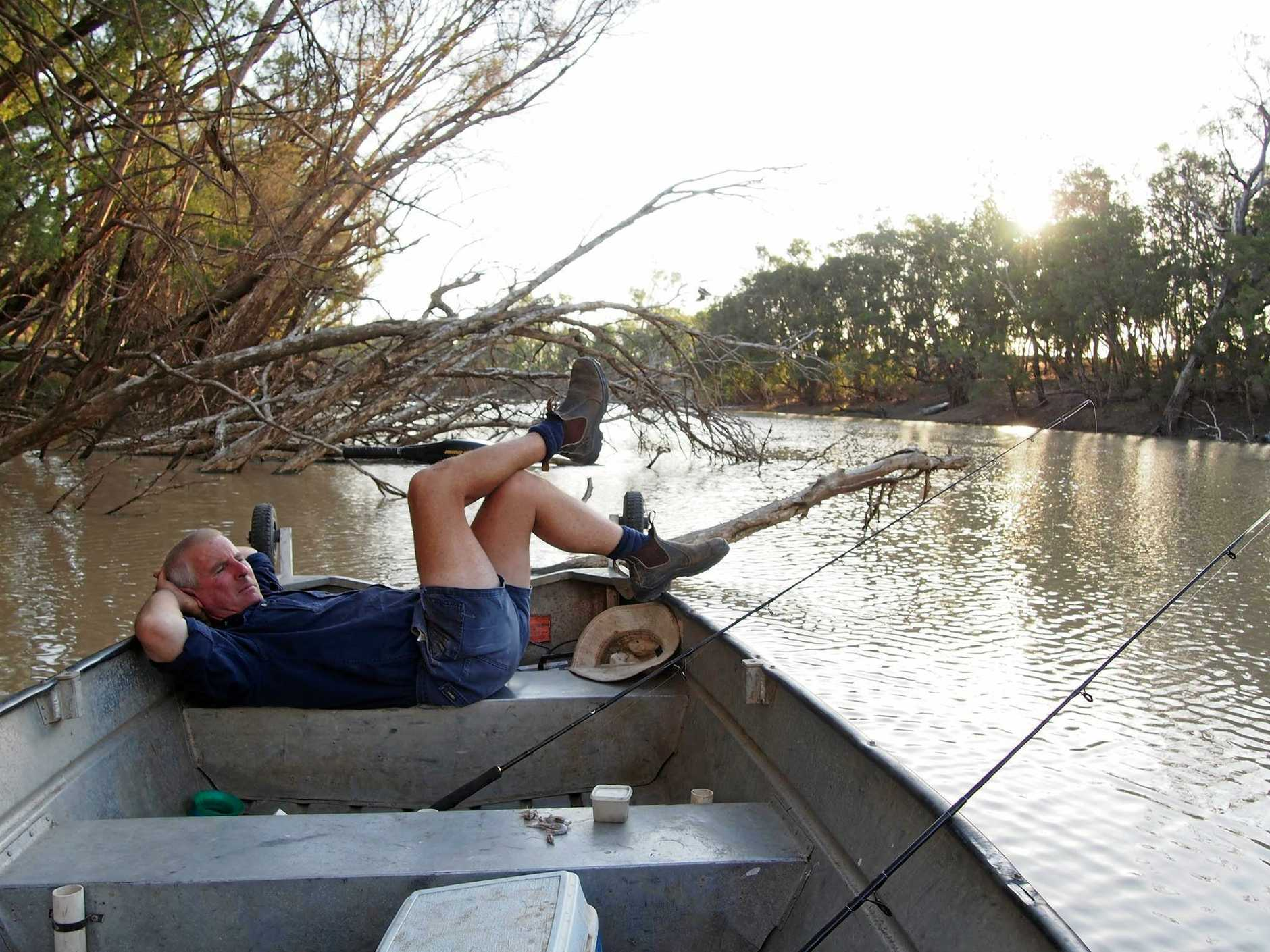 RELAXING RIVER: Paula Hetherington's shot of her husband took out second place in the lifestyle category of the QCWA state photography competition.
