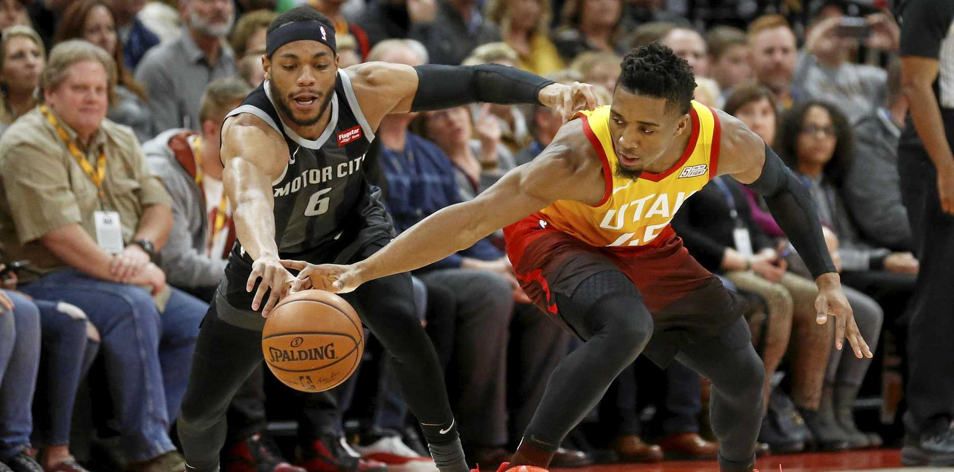 Detroit Pistons guard Bruce Brown attempts a steal from Utah Jazz guard Donovan Mitchell during the first half.  Picture: Rick Bowmer/AP