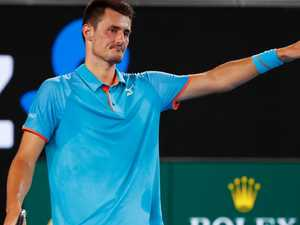 Tomic taunts Hewitt: 'Come one metre from me if he is a man'
