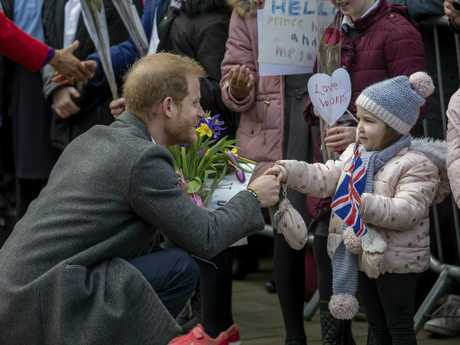 Prince Harry chatted with youngsters in the crowd. Picture: Charlotte Graham/AP