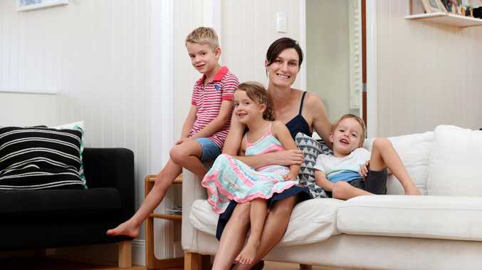Helen Lobegeiger with 5-year-old triplets Charlie, Matilda, and Angus Cottler, who live in the inner-Brisbane suburb of Gordon Park. The family is bucking the trend toward smaller families in the inner-city. Pics Tara Croser.