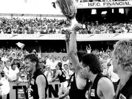 1987 Grand Final. Carlton v Hawthorn. MCG. Tom Alvin holds the premiership cup.