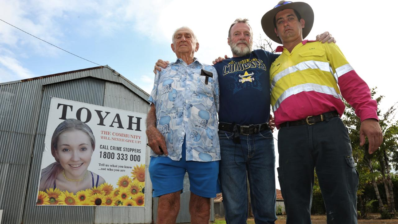 Toyah Cordingley's family members Sam Lemura and Adam Bugeja and family friend Wayne 'Prong' Trimble (centre) in front of the roadside sign erected. Picture: PETER CARRUTHERS