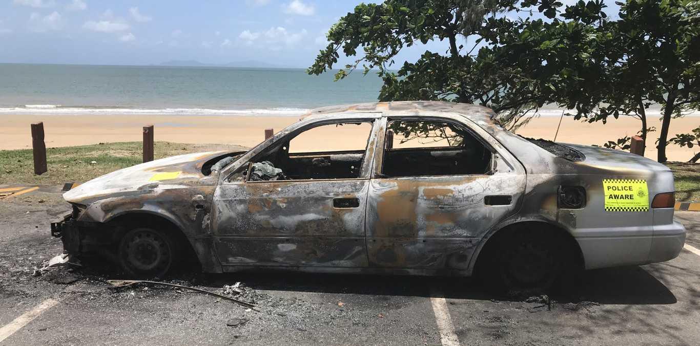 Burnt out car at Blacks Beach Park.