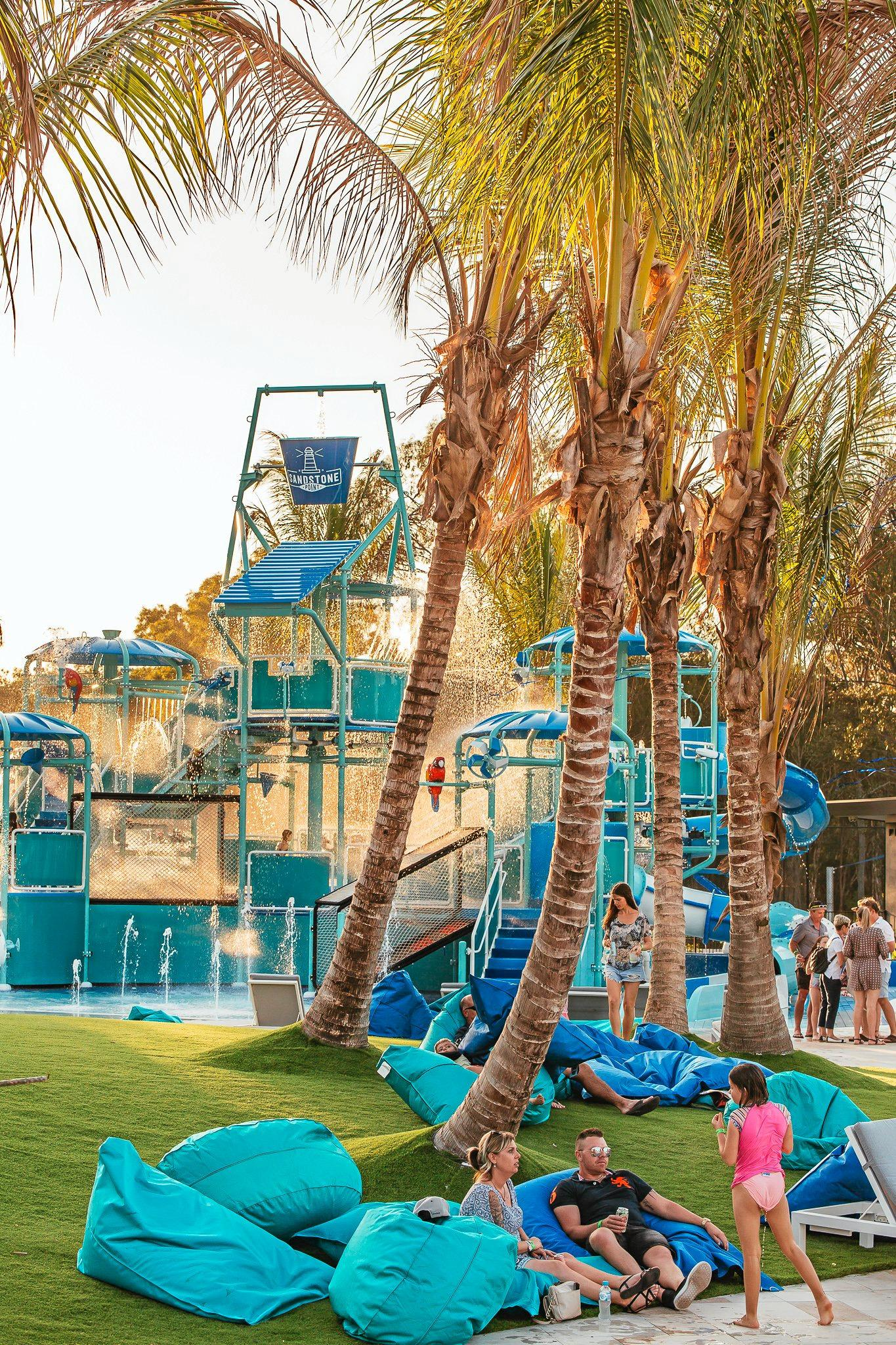 Relax under the shady palms while the kids take a dip.