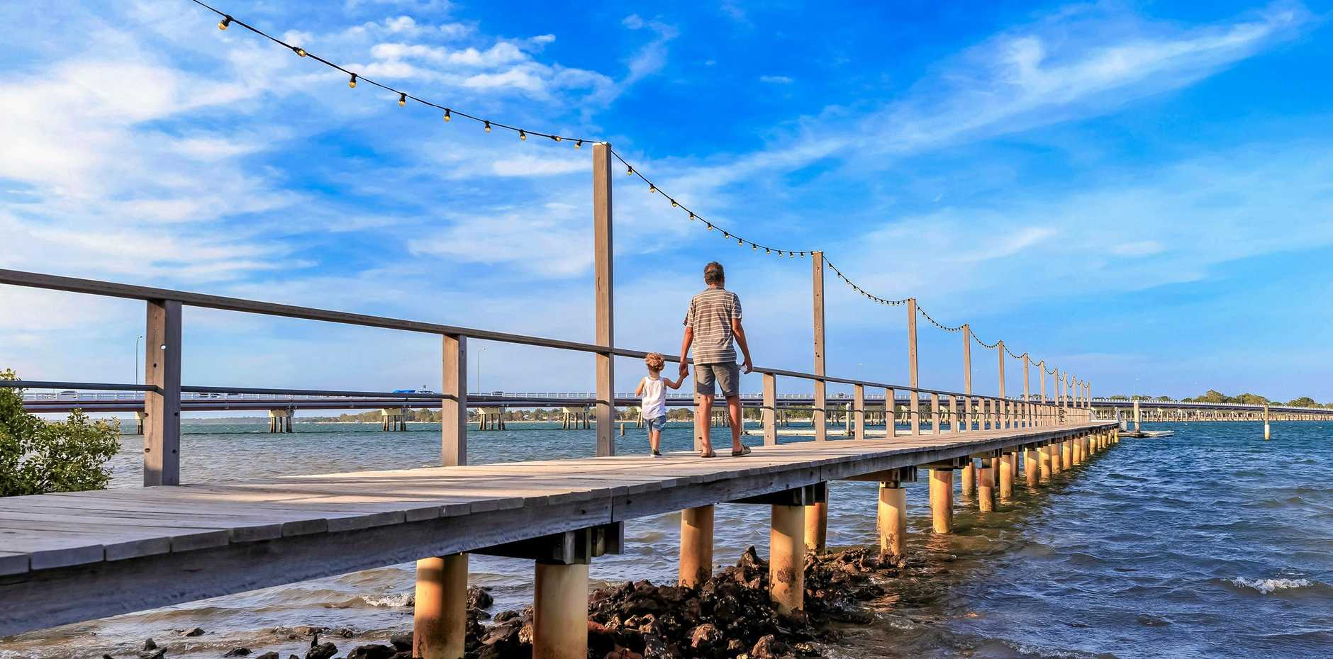 The jetty at Sandstone Point Hotel with views of Bribie Island.