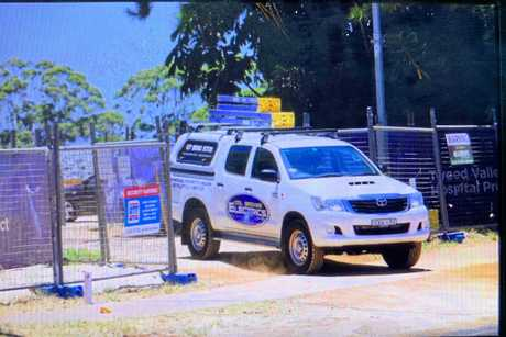 An electrician enters the Tweed Valley Hospital site after work was stopped due to several safety breaches.
