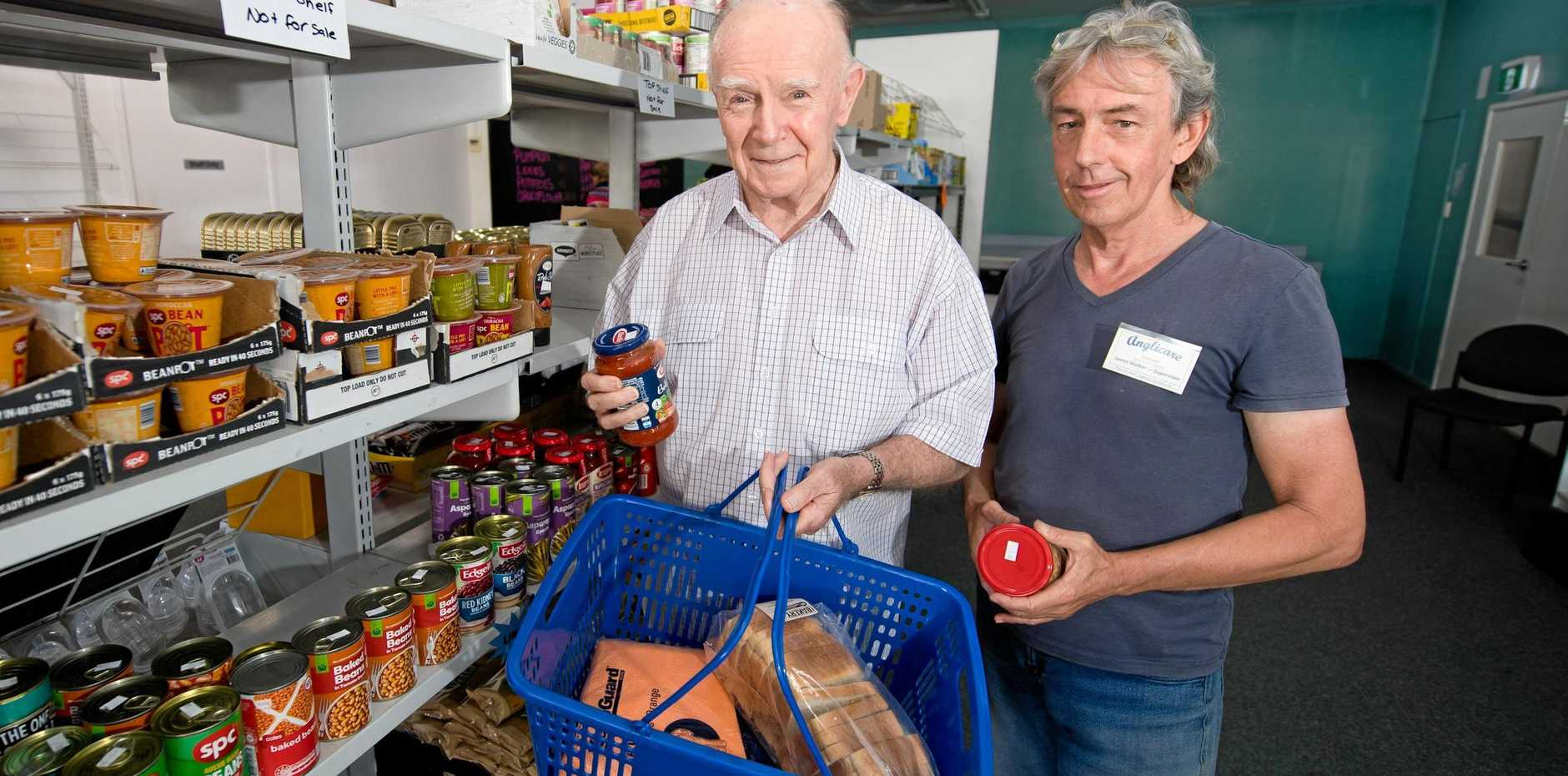 FEELING THE PINCH: Anglicare Mackay Whitsunday director John Langford, with Food Assist Centre supervisor James Walker, at the Wood St store.