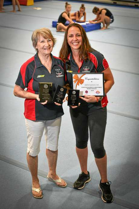 COVETED AWARDS: Anna Turetschek and Amy Dew proudly display the Club Administrator Award, Club Hosting Award and Club Promotion and Community Engagement Award.