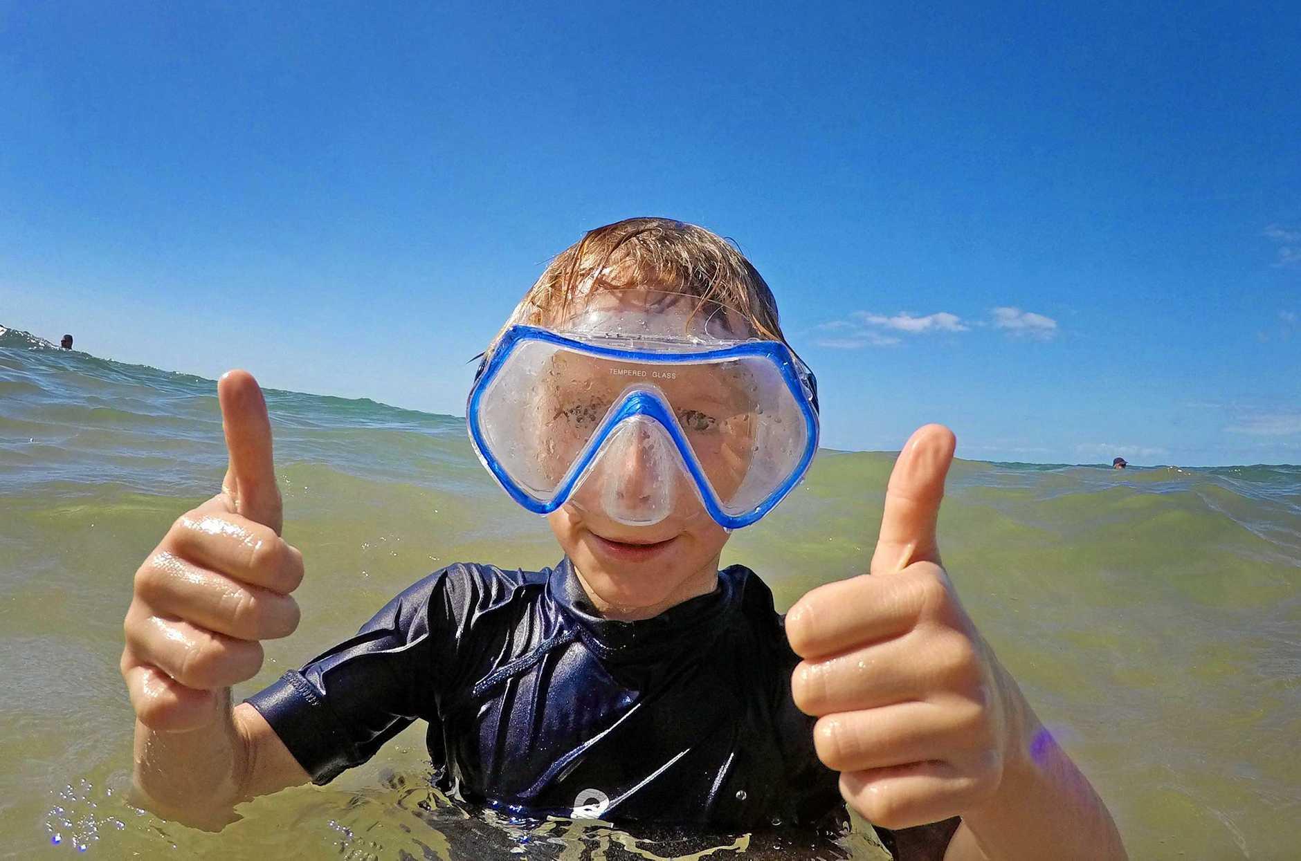 Temperatures set to soar - 10yo Elijah Haupstein cools off in the waters of Torquay Beach.