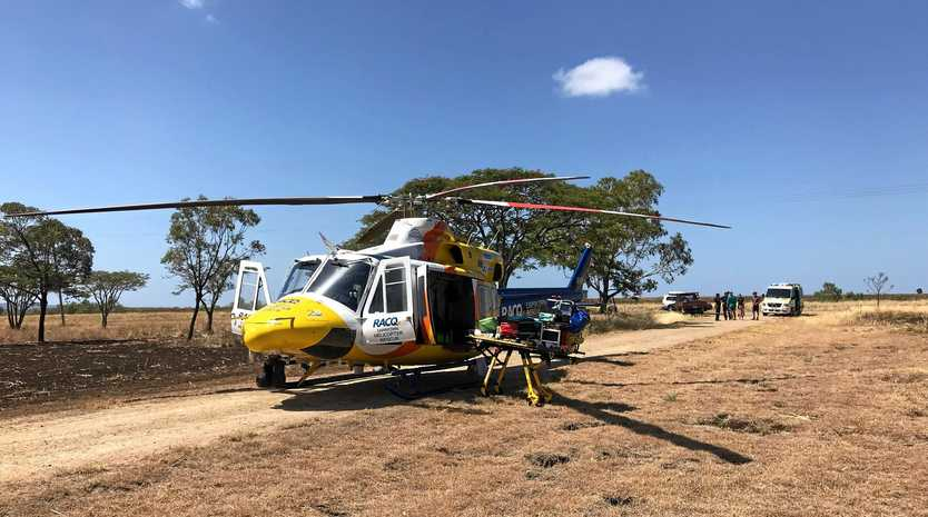A male in his early teens sustained lower leg injuries in a farm vehicle roll over.