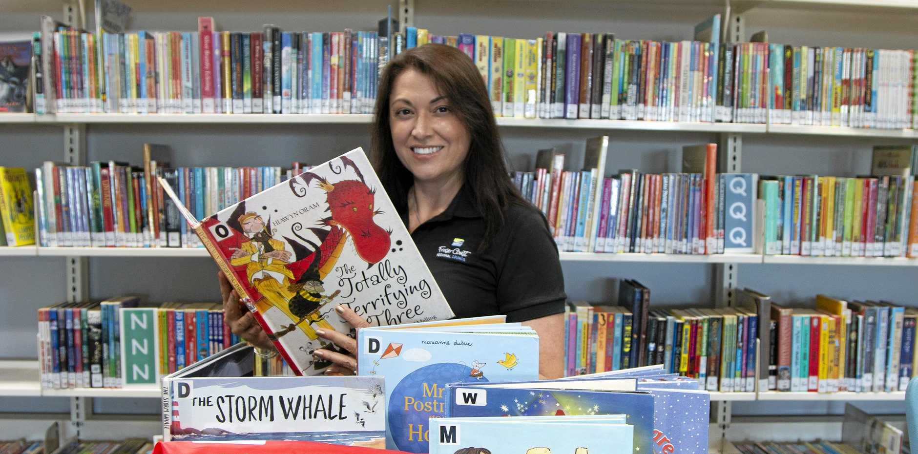GIVING KIDS ANOTHER CHANCE: Fraser Coast council executive assistant Dani Nutall helps give back to foster kids through the Pyjama Foundation every week by teaching them to read and imparting learning skills.