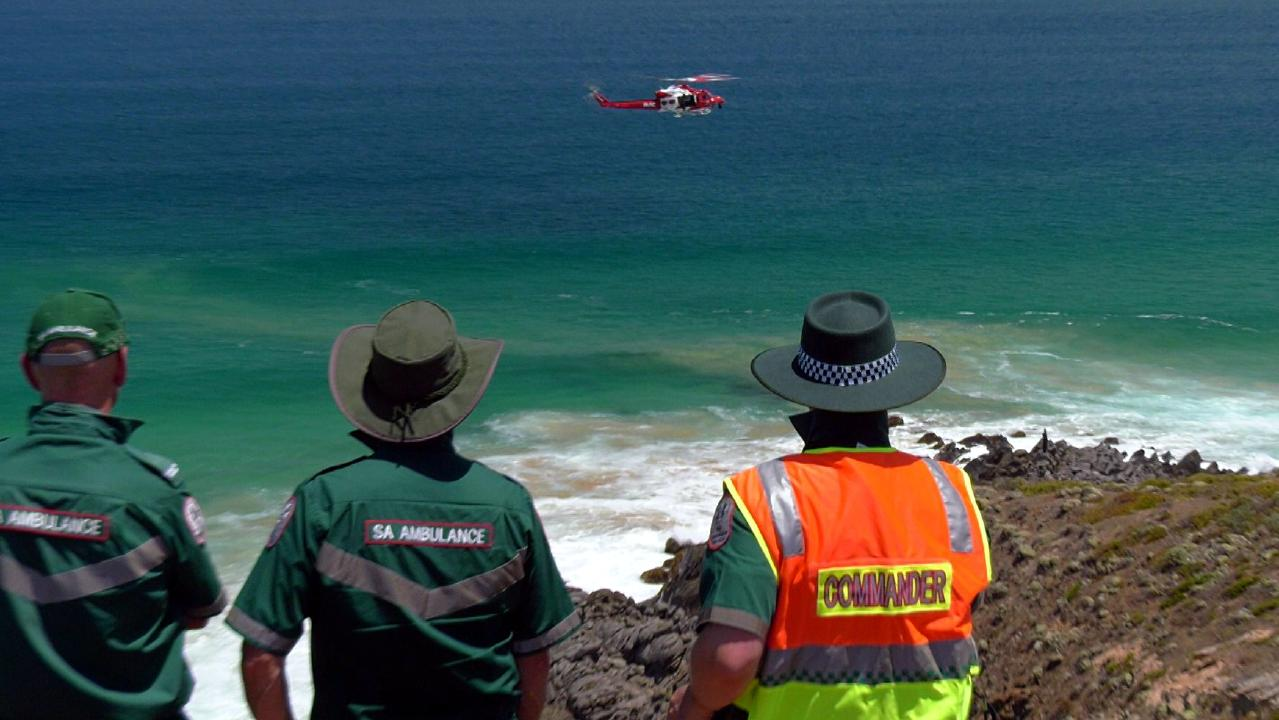 The search continues for a teenage swimmer in the water off Parsons Beach, near Waitpinga, on the Fleurieu Peninsula. Picture: Gary Juleff