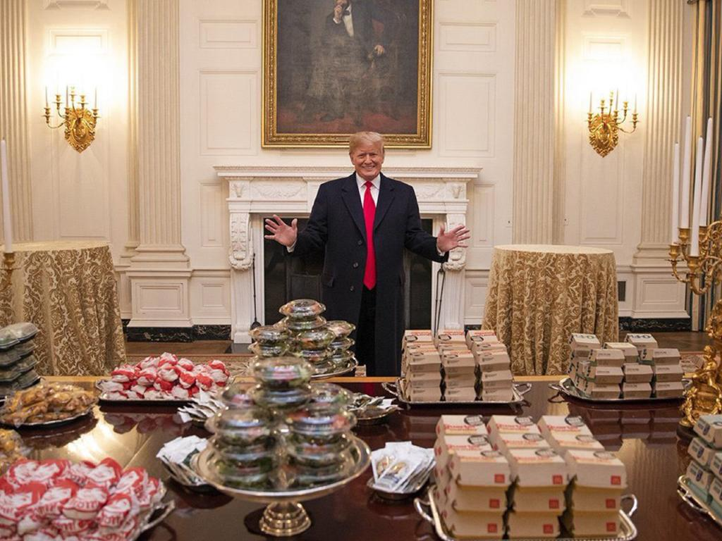 Mr Trump presided over a meal of junk food at the White House for college football champions Clemson Tigers, with his chefs on unpaid leave.