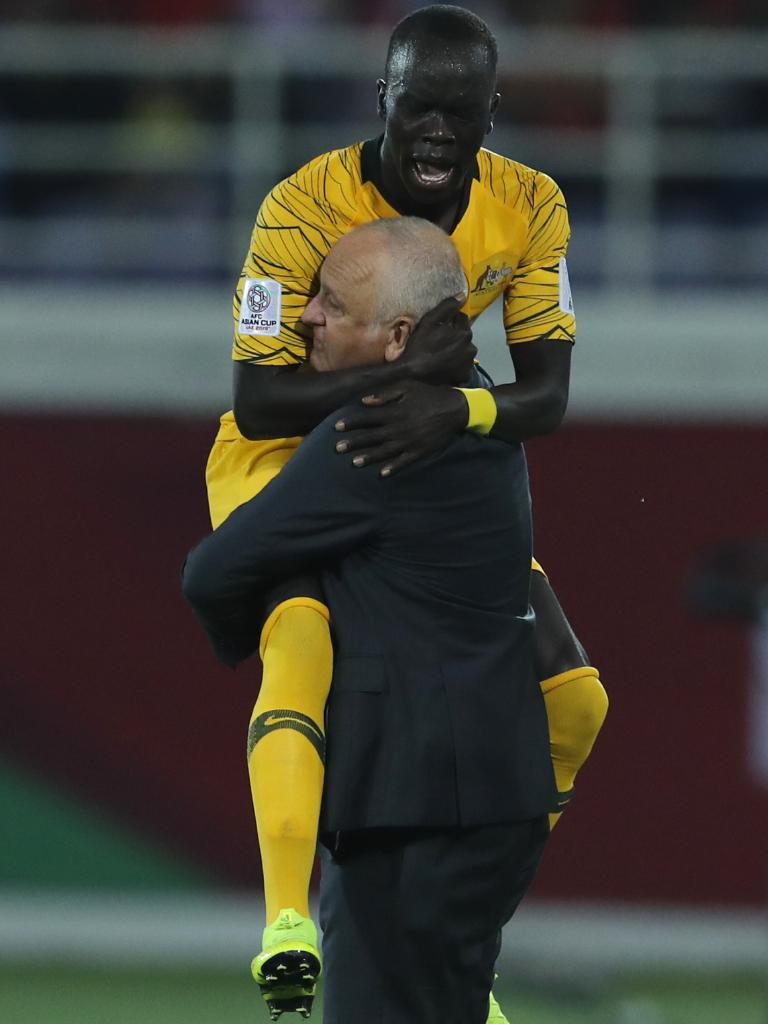 Mabil celebrates with Graham Arnold. Picture: AP