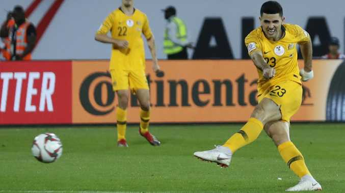Tom Rogic buries his stoppage-time goal. Picture: AP