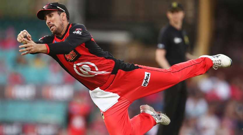 The Renegades' Tom Cooper launches to catch the Sixers' Moises Henriques on Wednesday night. Picture: Getty Images