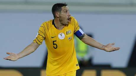 Mark Milligan is undecided about his playing future. (AP Photo/Hassan Ammar)
