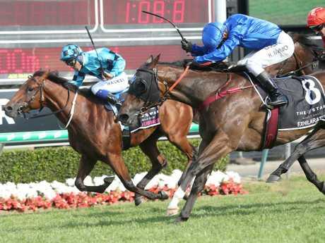 McEvoy rides Exhilarates (centre) to victory in the Magic Millions 2YO Classic. Photo: Jono Searle