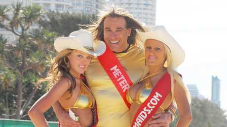 Gold Coast meter maid Warwick Capper (C) with meter maids Ashley Carr and Sandi Kovacevic in Surfers Paradise : PicPaul/Riley
