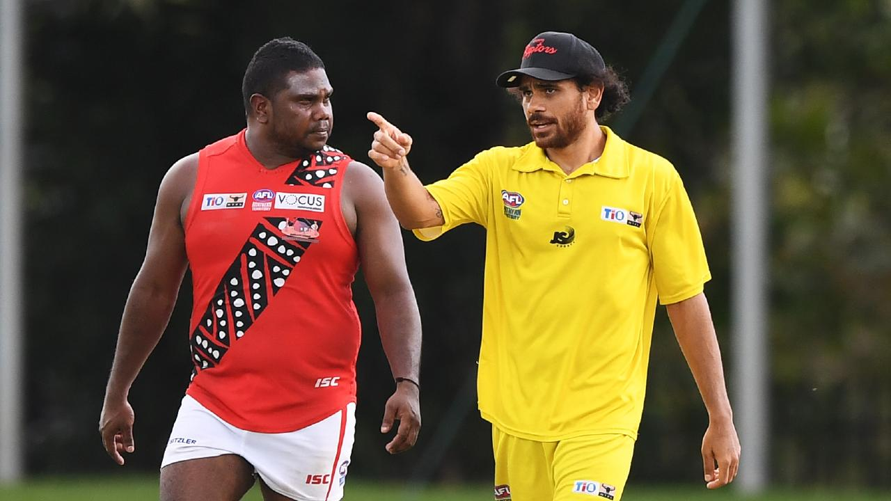 Tiwi runner Cyril Rioli and forward Austin Wonaeamirri credit: Felicity Elliott/AFLNT Media