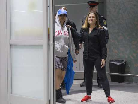Rahaf Mohammed Alqunun walks with Canadian Minister of Foreign Affairs Chrystia Freeland as she arrives in Toronto. Picture: Chris Young/The Canadian Press