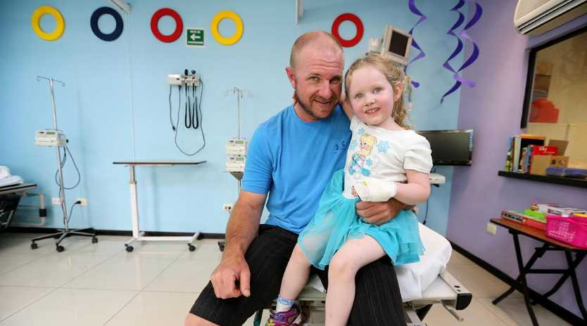 Annabelle Potts and her dad Adam during a visit to Clinica 0-19 in Mexico for treatment. Picture: Nathan Edwards.