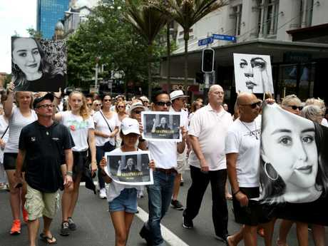 Several hundred people walk up Auckland's Queen Street in a silent march to remember Grace Millane. Picture: Phil Walter/Getty Images