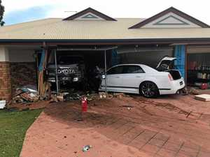 Car crashes into house, barely missing children