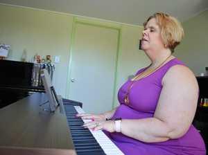Blind teacher helps others find their voice