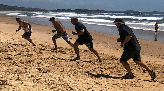 Players dig deep during the beach sprints section of the Lower Clarence Magpies pre-season training session at Brooms Head.