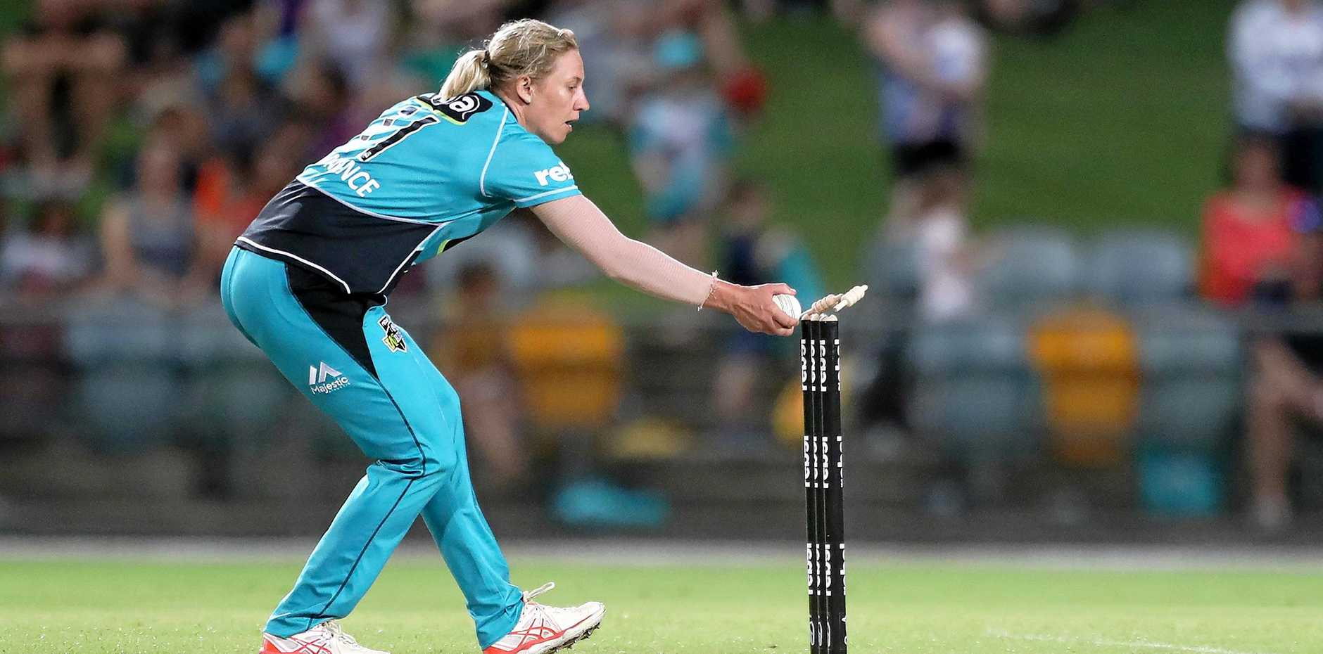 TOP FORM: Delissa Kimmince of the Heat runs out Sydney Thunder's Rachel Trenaman off her own bowling during the Women's Big Bash League (WBBL) match in Cairns. The same teams meet in a semi-final today.