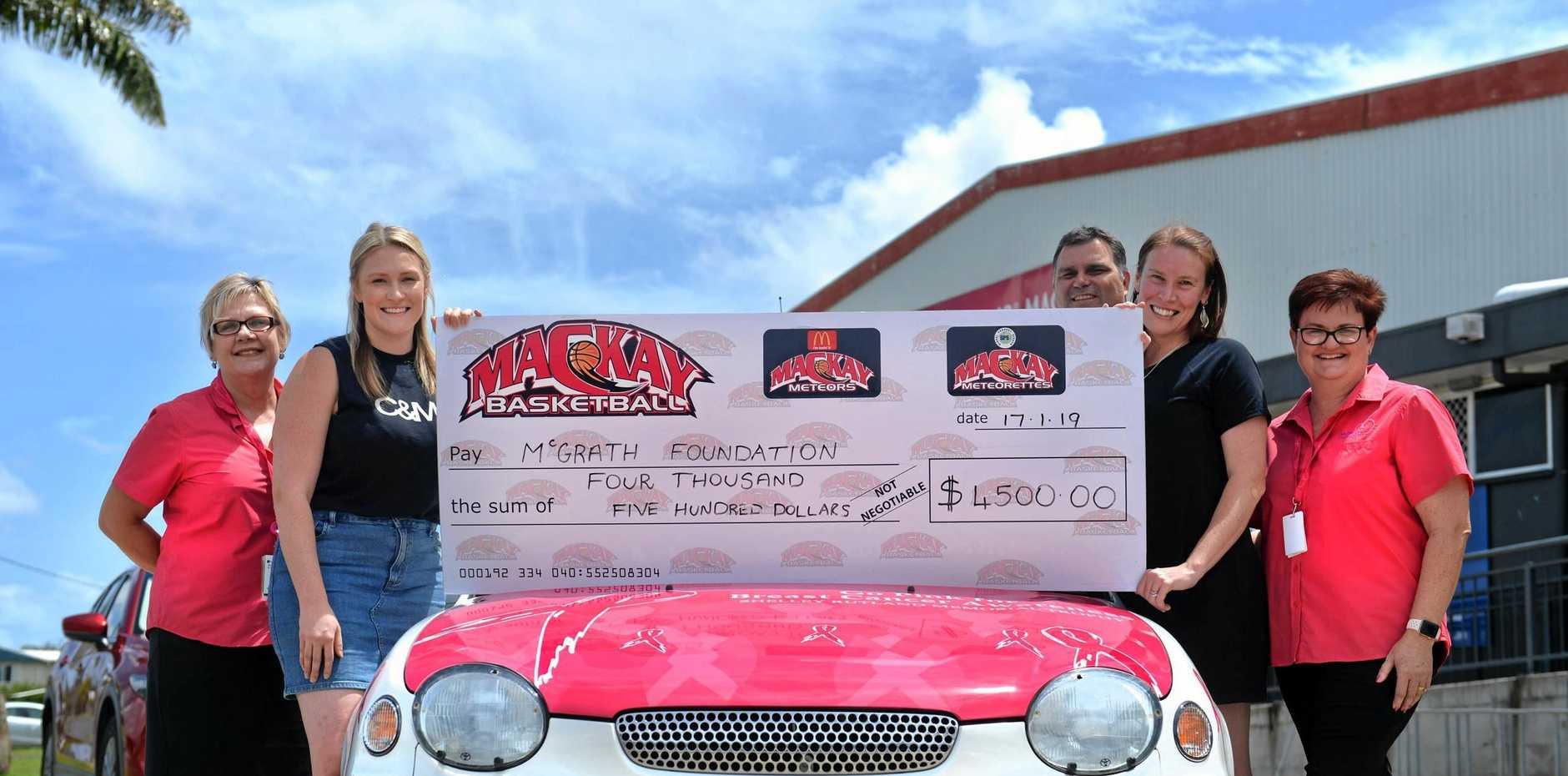 Liz Drefke, Kelsie Rutland, Wade Rebetzke, Courtney Rutland and Sasha MacDonald with a $500 cheque from the money raised for the McGrath Foundation via the 2018 Shelley Rutland Memorial Trophy match.