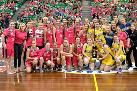 Kelsie Rutland (left) with Meteorettes and Townsville players post match at the Crater in July, 2018.
