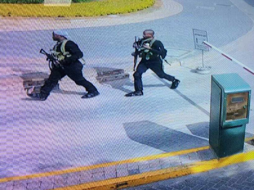 In this grab taken from security camera footage released to the local media, heavily armed attackers walk in the compound of a hotel in Nairobi. Picture: AP